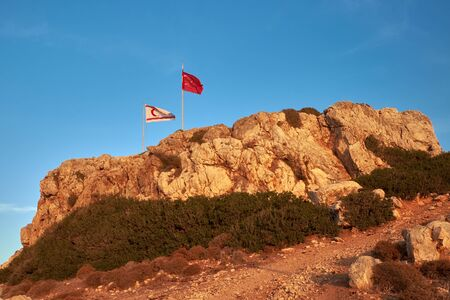 Flags of Turkey and the Turkish Republic of Northern Cyprus on the north-easternmost point promontory of the Mediterranean island of Cyprus. Karpass Peninsula. Cape Saint Andrew. Zafer Burnu.