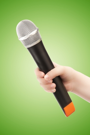 Hand with Microphone on Green - Interview photo