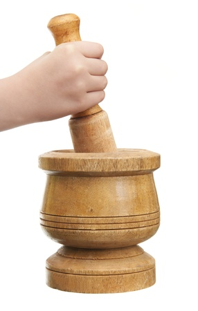 Hand with Pestle and Kitchen Mortar on White Stock Photo - 13605199