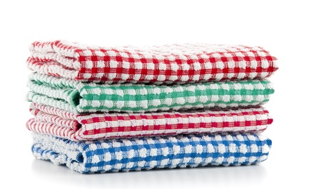 Colorful Housekeeping Towels Stacked over White photo