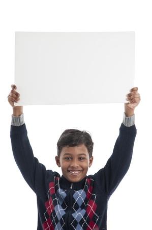 Smiling Boy Holding Blank Board Stock Photo