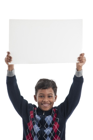 child holding sign: Smiling Boy Holding Blank Board Stock Photo