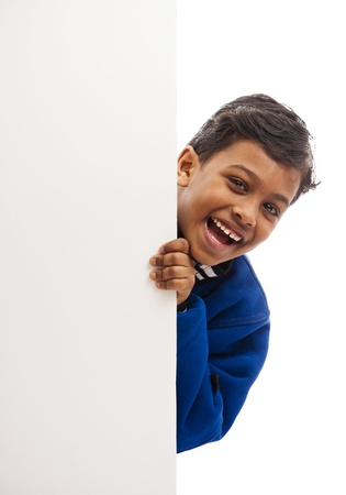 hands behind head: Happy Boy Behind Blank Board Stock Photo