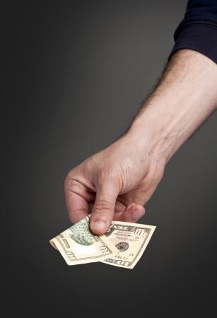 serial: Paying Dollars Stock Photo
