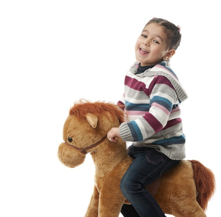 Ni�a feliz en Rocking Horse photo