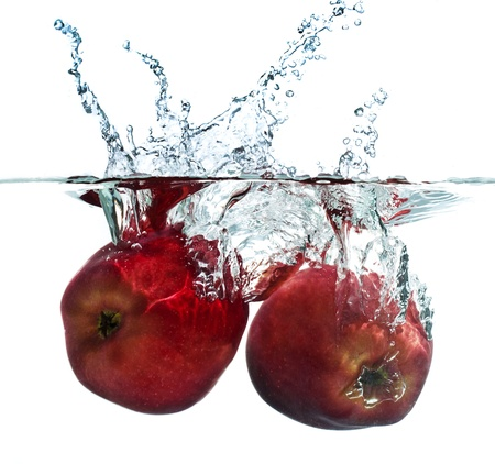 dropping: Apple Splash Stock Photo