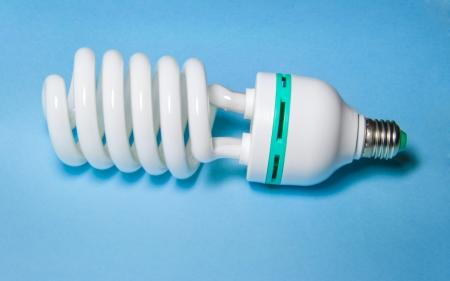 low light: Low Energy Light Bulb On Blue Background