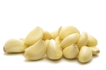 garlic clove: Peeled Garlic Cloves Isolated on White Background