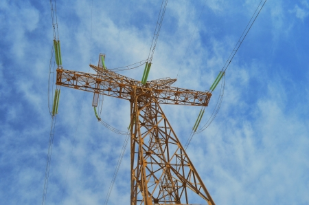 High Voltage Pole over Blue Sky photo
