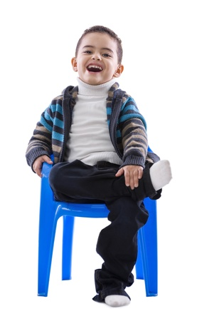 Handsome Laughing Boy Sitting Isolated on White Background