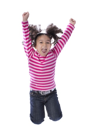 Little Girl Jumping with Joy Isolated on White Background photo