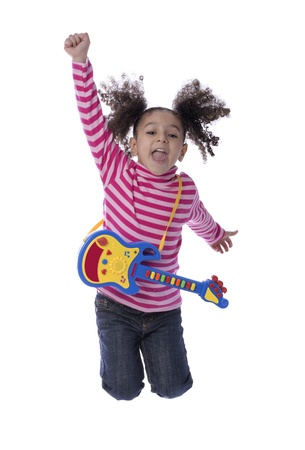 Little Girl Jumping with Toy Guitar Isolated on White Background photo