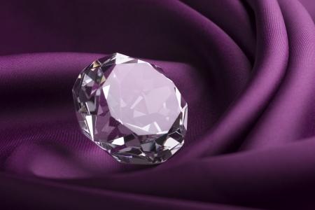 Shiny Expensive Translucent Diamond over Purple Silk Fabric photo