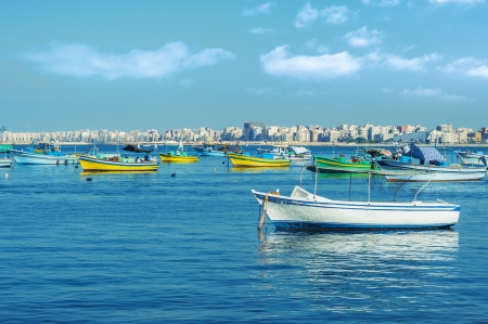 alexandria egypt: Harbor of Fishing Boats Floating on Blue Sea Water
