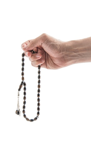 Male Hand with Rosary Isolated on White Background photo
