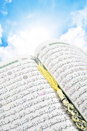 Heaven's Holy Quran With Rosary over Blue Sky Standard-Bild