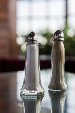 Salt and Pepper Shakers on a Restaurant Tabletop photo