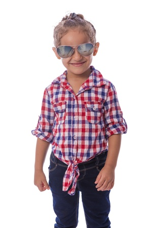 Beautiful Young Girl with Sunglasses in Checkered Shirt and Jeans photo