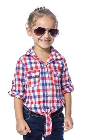 Beautiful Happy Young Girl in Checkered Shirt and Jeans photo