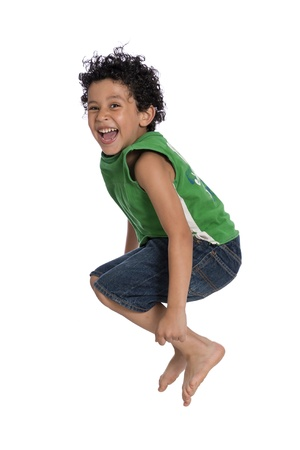 air jump: Active Joyful Boy Jumping with Joy over White Background