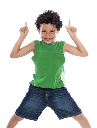 Happy Boy with Fingers Pointing Up over White Background