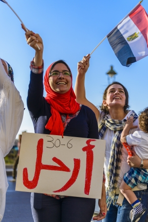 egypt revolution: Egyptian Girl Protesting with LEAVE Sign - Alexandria, Sidi Gaber, 30 June 2013 Editorial