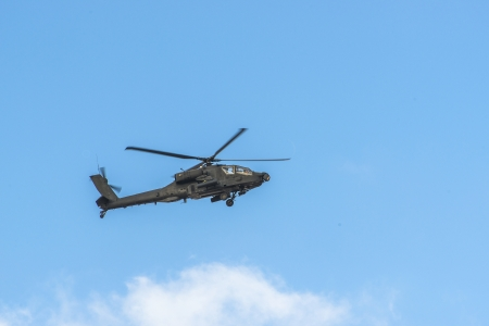 united states air force: Apache Helicopter Flying Over Blue Sky Stock Photo