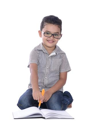 Adorable Happy School Boy Studying Isolated on White Background photo