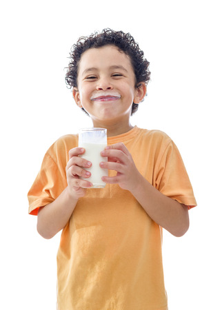 Little Boy with Glass of Milk Isolated on White Background Foto de archivo