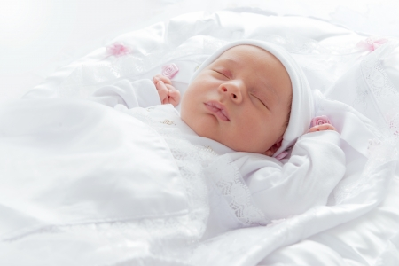 Lovely New Born Baby Sleeping in Bed Stock Photo