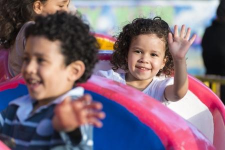 Happy Young Girl Having Fun at Amusement Park
