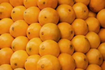 mandarin oranges: Pile of Fesh Orange Fruits Crop Texture Background