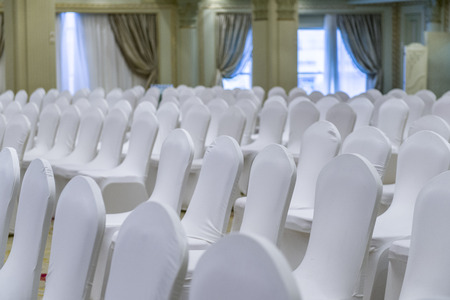 wedding chairs: Wedding Hall Full of White Wedding Chairs  Stock Photo