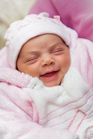 A Cute Smile of A Little Sleeping Newborn Baby photo