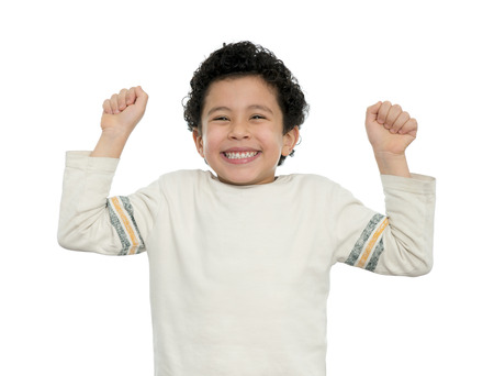 child finger: Happy Boy Excited With His Arms Up Isolated on White Stock Photo
