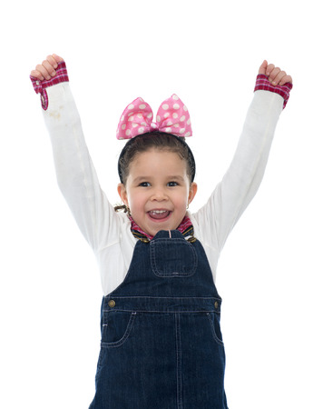 hand movements: Happy Little Girl Raising Her Arms Up In The Air Isolated on White Stock Photo