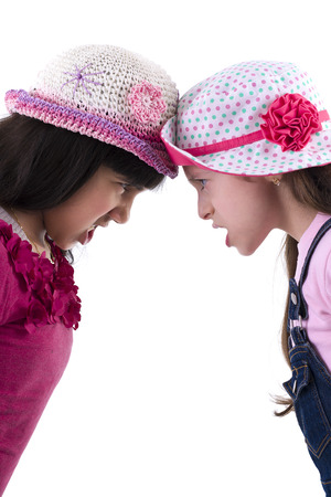Two Sad Girls in Quarrel Isolated on White Background photo