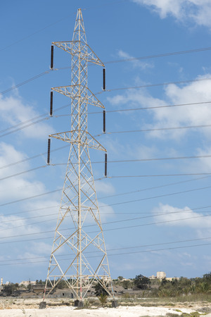 Electrical Transmission Tower Over Blue Sky