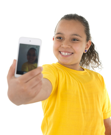 Young Girl Taking a Self Portrait With Phone Camera Isolated on White Background photo