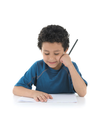 School Boy Thinking about His Homework Isolated on White Background photo