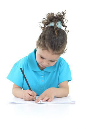 Little Girl Doing Her Homework Isolated on White Background photo