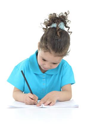 Little Girl Doing Her Homework Isolated on White Background photo