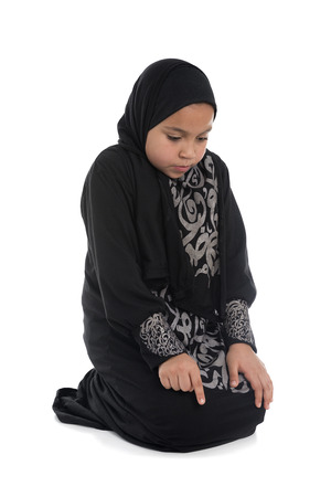 Muslim Girl Praying Isolated on White Background photo