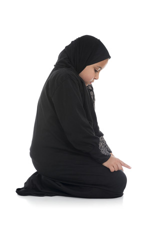 islamic prayer: Young Muslim Girl Praying Sideview Isolated on White Background