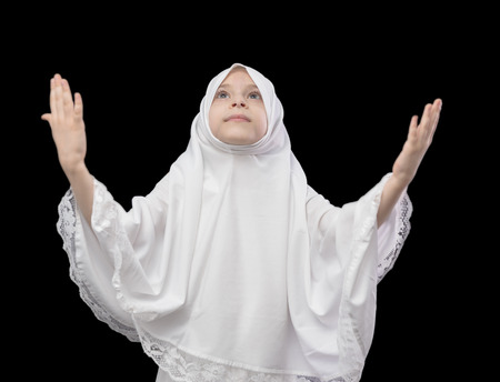 Muslim Girl Prayer on Black Background photo