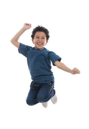 Active Happy Boy Jumping with Joy Isolated on White Background photo
