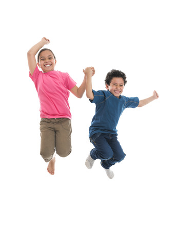 Active Happy Kids Jumping with Joy Isolated on White Background