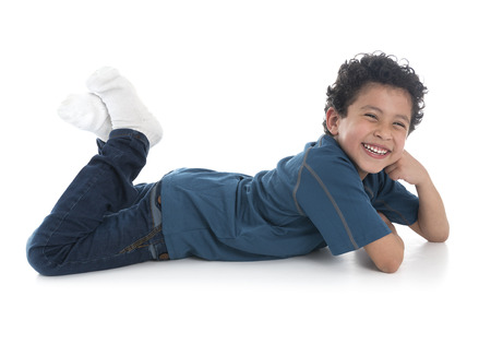 the lovely boy: Beautiful Boy Laying Down Isolated on White Background