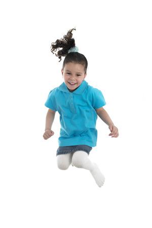hopping: Active Joyful Girl Jumping with Joy Isolated on White Background