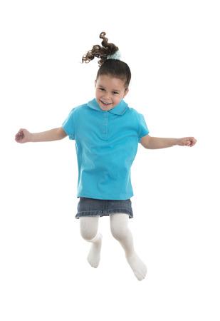 hopping: Active Joyful Young Girl Jumping with Joy Isolated on White Background